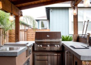 Inset Patio kitchen allows for friends to gather around the grill.