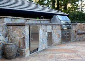 stonework inset outdoor kitchen