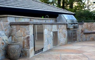 stonework inset outdoor kitchen